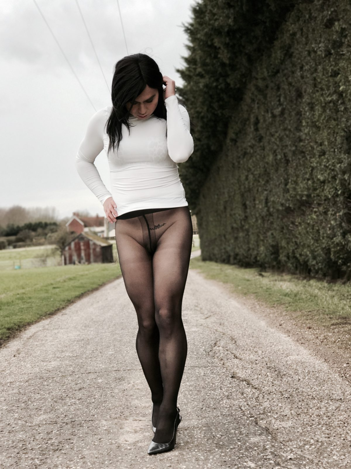 Horny tranny in turtleneck top and black pantyhose masturbating cum