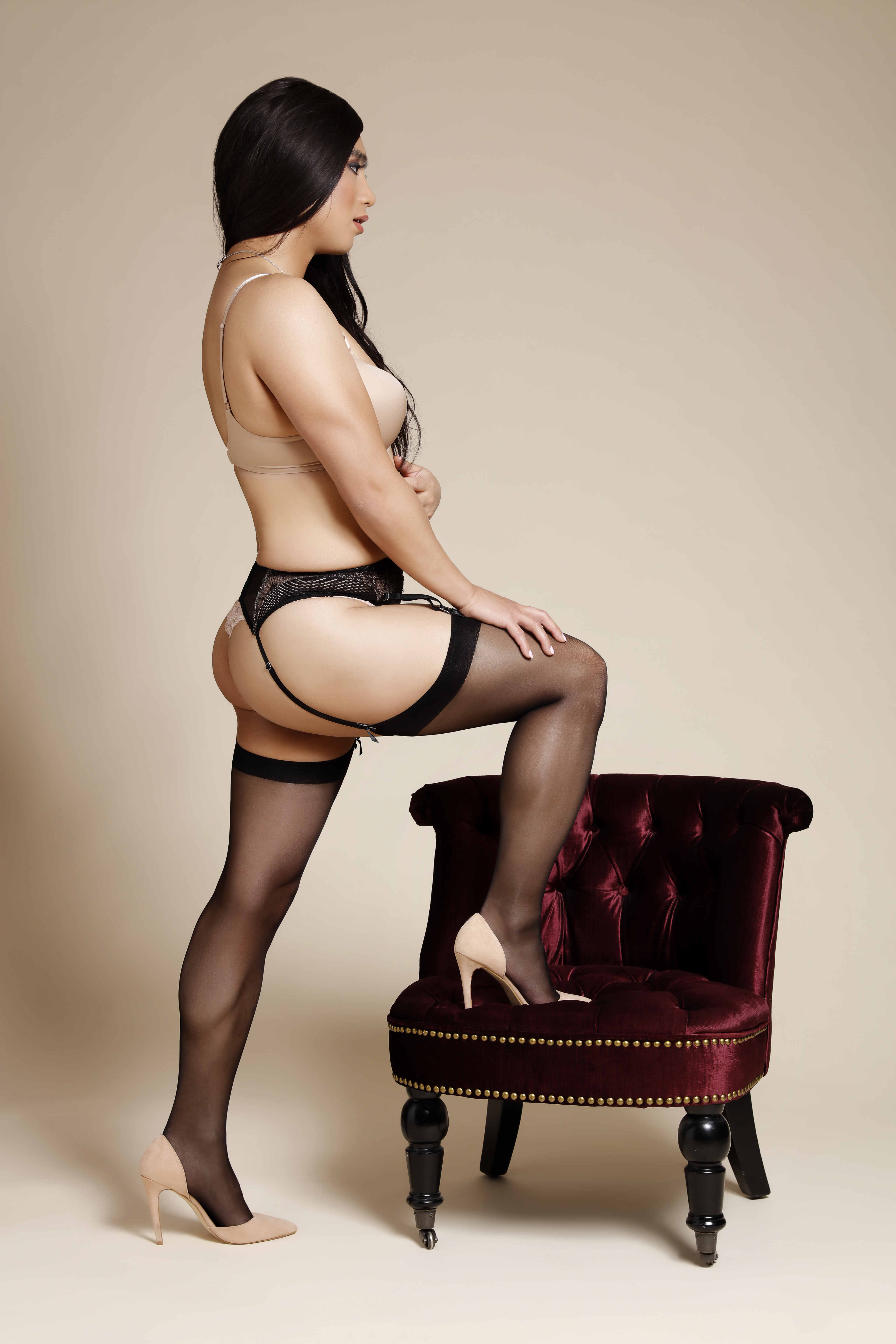 Nude satin lingerie black stockings and suspender