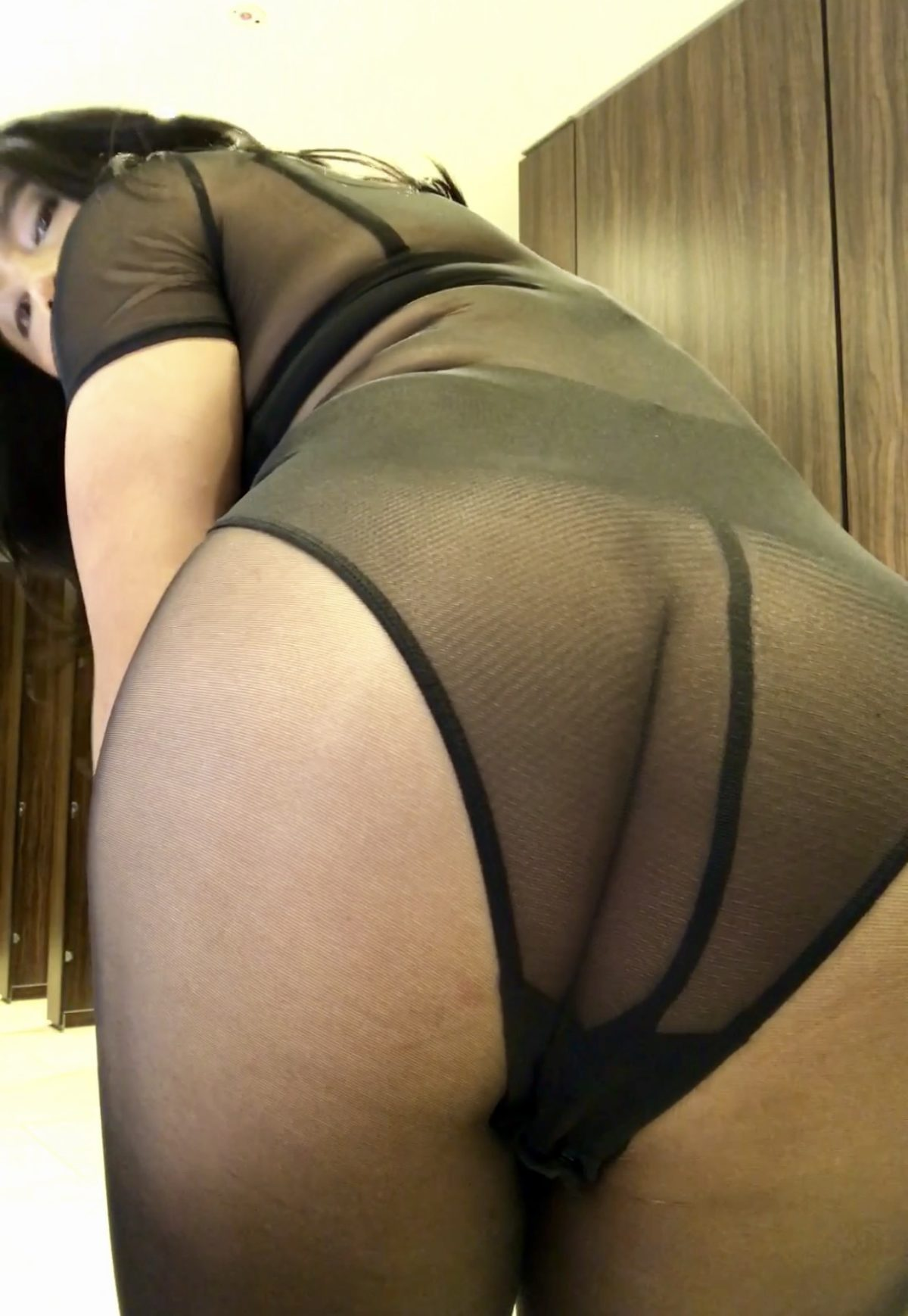 Black pantyhose and mesh top