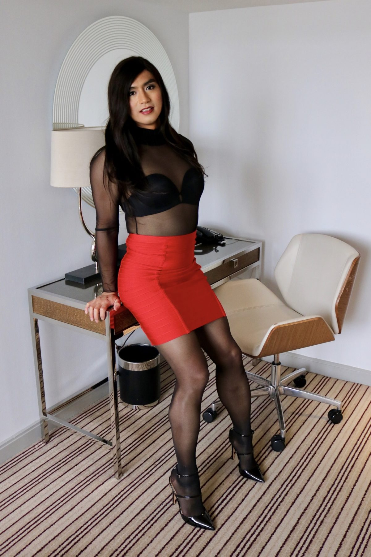 Alina teasing in black mesh bodysuit sheer pantyhose, red bandage skirt with full back zip and CFM heels